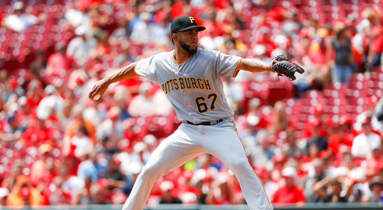 Pittsburgh Pirates starting pitcher Dario Agrazal throws in the first inning of a baseball game against the Cincinnati Reds, Wednesday, July 31, 2019, in Cincinnati.