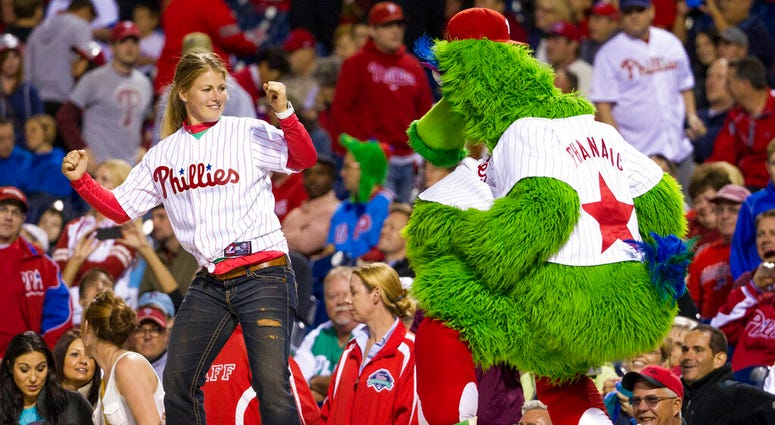 the Phillies Phanatic dancing with a fan
