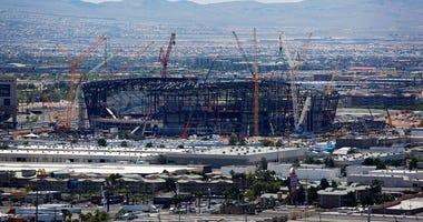 construction cranes surround the football stadium under construction in Las Vegas