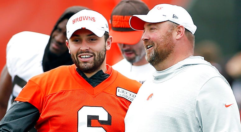 Cleveland Browns quarterback Baker Mayfield (6) talks with head coach Freddie Kitchens