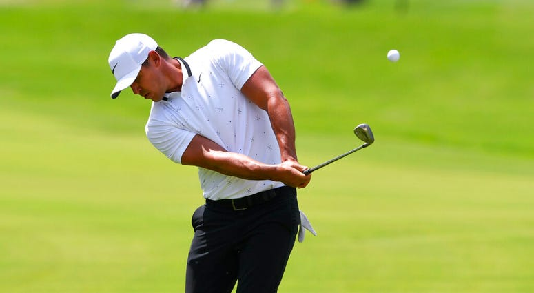 Brooks Koepka chips to the fourth green during the first round of the Tour Championship golf tournament Friday, Aug. 23, 2019, in Atlanta.
