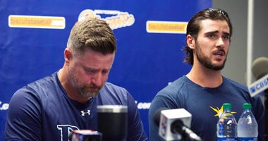 Montgomery Biscuits manager Morgan Ensberg, left, fights back tears as Ryan Thompson, a pitcher with the team, talks about teammate Blake Bivens