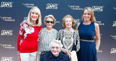 "Norma Hunt, Martha Ford, Virginia McCaskey, seated, Patricia Rooney and Jane Skinner Goodell pose at the premiere of ""A Lifetime of Sundays,"""