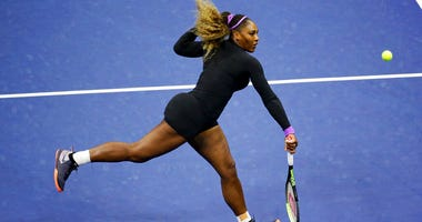 Serena Williams, of the United States, returns a shot to Elina Svitolina, of Ukraine, during the semifinals of the U.S. Open tennis championships Thursday, Sept. 5, 2019, in New York.