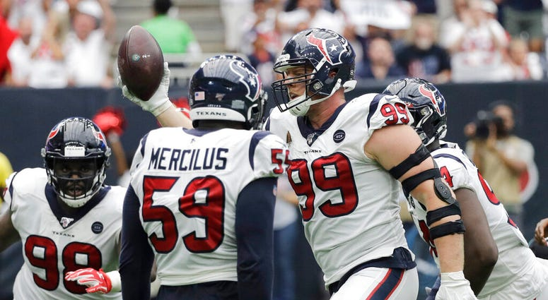 Houston Texans defensive end J.J. Watt (99) celebrates after he recovered a ball fumbled by Jacksonville Jaguars quarterback Gardner Minshew during the second half of an NFL football game Sunday, Sept. 15, 2019, in Houston. (