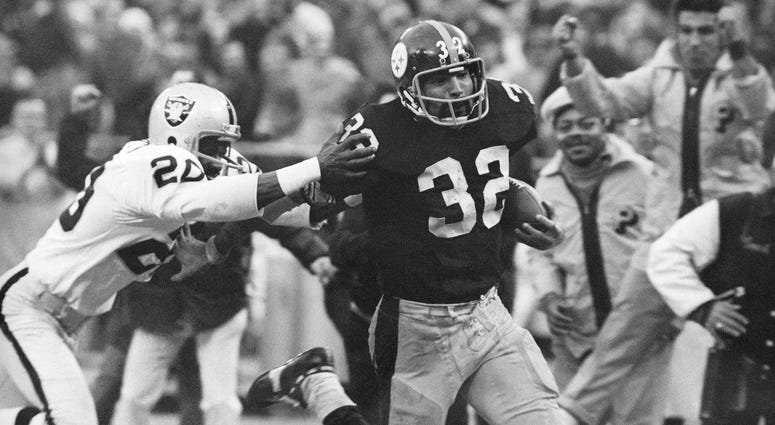 Immaculate Reception: Pittsburgh Steelers' Franco Harris eludes a tackle by Oakland Raiders' Jimmy Warren as he runs 42-yards for a touchdown after catching a deflected pass during an AFC Divisional NFL football playoff game in Pittsburgh.