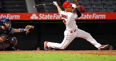 Los Angeles Angels' Andrelton Simmons, right, hits a walk-off single during the 12th inning of a baseball game against the Houston Astros Thursday, Sept. 26, 2019, in Anaheim, Calif.
