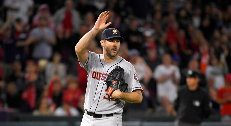 Houston Astros starting pitcher Justin Verlander waves to fans striking out Los Angeles Angels' Kole Calhoun forays 3,000th career strikeout during the fourth inning of a baseball game Saturday, Sept. 28, 2019, in Anaheim, Calif.
