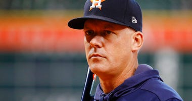 Houston Astros manager AJ Hinch watches during batting practice before Game 1 of baseball's American League Championship Series against the New York Yankees Saturday, Oct. 12, 2019, in Houston.