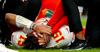 Kansas City Chiefs quarterback Patrick Mahomes (15) is helped by trainers after getting injured against the Denver Broncos during the first half of an NFL football game, Thursday, Oct. 17, 2019, in Denver.