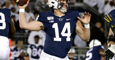 Penn State quarterback Sean Clifford throws a pass during the first half of the team's NCAA college football game against Michigan in State College, Pa., Saturday, Oct. 19, 2019.