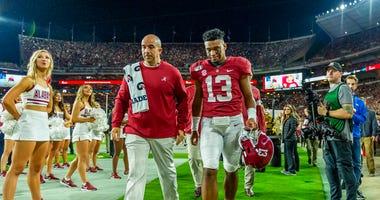 Alabama quarterback Tua Tagovailoa (13) walks off the field hurt against Tennessee during the first half of an NCAA college football game, Saturday, Oct. 19, 2019, in Tuscaloosa, Ala.