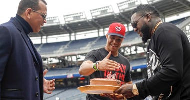 Alex Rodriguez and David Ortiz give Washington Nationals' Juan Soto a cake for his 21st birthday before Game 3 of the baseball World Series against the Houston Astros Friday, Oct. 25, 2019, in Washington.