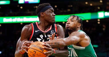 Boston Celtics' Marcus Smart (36) defends against Toronto Raptors' Pascal Siakam during the second half of an NBA basketball game in Boston, Friday, Oct. 25, 2019.