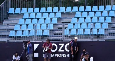 Tiger Woods of the United States lines up a putt near the empty spectators seat on the 18th green during the second round of the Zozo Championship PGA Tour at the Accordia Golf Narashino country club in Inzai, east of Tokyo, Japan, Saturday, Oct. 26, 2019