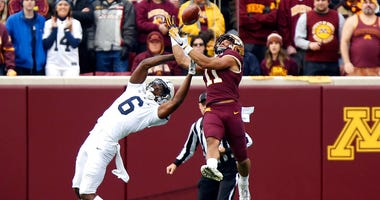 Minnesota defensive back Antoine Winfield Jr. (11) intercepts the ball intended for Penn State wide receiver Justin Shorter (6) during an NCAA college football game, Saturday, Nov. 9, 2019, in Minneapolis.
