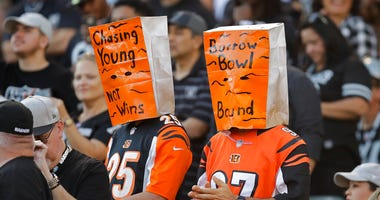 Cincinnati Bengals fans wears paper bags on their heads during the second half of an NFL football game against the Oakland Raiders in Oakland, Calif., Sunday, Nov. 17, 2019.