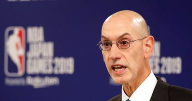 NBA Commissioner Adam Silver speaks at a news conference before an NBA preseason basketball game between the Houston Rockets and the Toronto Raptors in Saitama, Japan. A person familiar with the negotiations says the NBA is working with the players' union