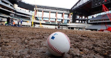 A baseball lies on packed dirt after for a short batting practice during a tour of the under construction baseball field at the new Texas Rangers stadium in Arlington, Texas, Wednesday, Dec. 4, 2019.