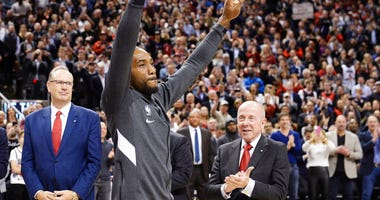 Former Toronto Raptors and now Los Angeles Clippers forward Kawhi Leonard salutes the crowd as he receives his 2019 NBA championship ring prior to an NBA basketball game, Wednesday, Dec. 11, 2019, in Toronto.