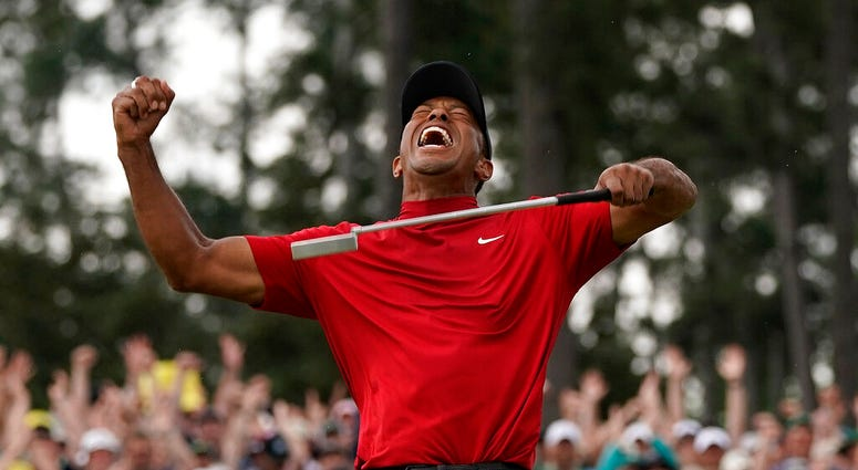 Tiger Woods reacts as he wins the Masters golf tournament in Augusta, Ga.