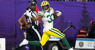 Green Bay Packers running back Aaron Jones runs for a 56-yard touchdown during the second half of the team's NFL football game against the Minnesota Vikings, Monday, Dec. 23, 2019, in Minneapolis.