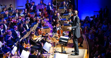 "Boston Celtics player Tacko Fall makes his debut as a guest conductor during the renowned Boston Pops orchestra's holiday concert in Boston. The 7-foot-6 center took the stage to lead the orchestra in a rendition of the song ""Sleigh Ride"" at Boston's Symp"