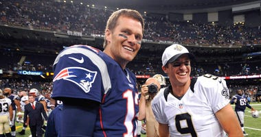 New England Patriots quarterback Tom Brady (12) and New Orleans Saints quarterback Drew Brees (9)