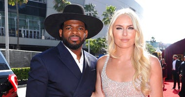 P.K. Subban, left, of the New Jersey Devils, and Lindsey Vonn