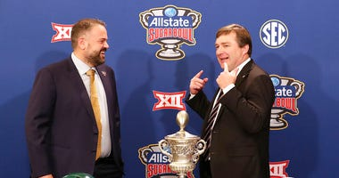 Georgia head coach Kirby Smart, right, tells Baylor head coach Matt Rhule you have to remember to smile during their photo opportunity with the Sugar Bowl trophy during an during an NCAA college football press conference, Tuesday, Dec. 31, 2019, in New Or