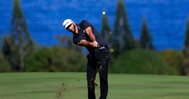 Dustin Johnson hits for the fourth fairway during the third round of the Tournament of Champions golf event at Kapalua Plantation Course in Kapalua, Hawaii. The course has gone through a refinement to prepare for the winners-only event on the PGA Tour tha