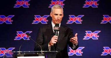 n this Feb. 7, 2019, file photo, Oliver Luck, XFL commissioner and CEO, makes comments during a news conference in Arlington, Texas, Thursday, Feb. 7, 2019.