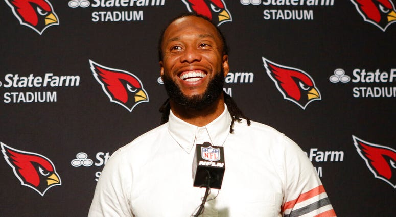 In this Oct. 6, 2019, file photo, Arizona Cardinals wide receiver Larry Fitzgerald attends a news conference after winning an NFL football game against the Cincinnati Bengals