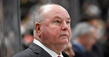 Minnesota Wild head coach Bruce Boudreau watches from the bench as his team plays against the Tampa Bay Lightning during the second period of an NHL hockey game Thursday, Jan. 16, 2020, in St. Paul, Minn.