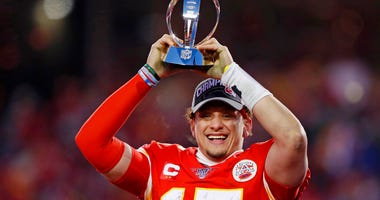 Kansas City Chiefs' Patrick Mahomes celebrates with the Lamar Hunt Trophy after the NFL AFC Championship football game against the Tennessee Titans Sunday, Jan. 19, 2020, in Kansas City, MO. The Chiefs won 35-24 to advance to Super Bowl 54.