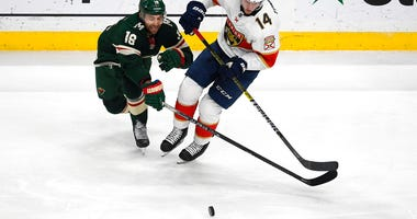 Minnesota Wild winger Jason Zucker (16) and Florida Panthers center Dominic Toninato battle for control of the puck during the first period of an NHL hockey game Monday, Jan. 20, 2020, in St. Paul, Minn.