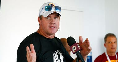 In this July 24, 2019, file photo, then-Washington Redskins head football coach Jay Gruden gestures during a news conference