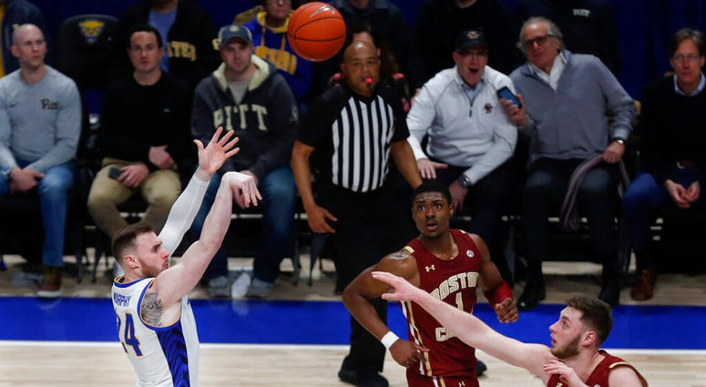 Pittsburgh's Ryan Murphy (24) hits a shot to put Pitt ahead to stay over Boston College's Nik Popovic with under five seconds left in the second half of an NCAA college basketball game, Wednesday, Jan. 22, 2020, in Pittsburgh. Pittsburgh won 74-72.