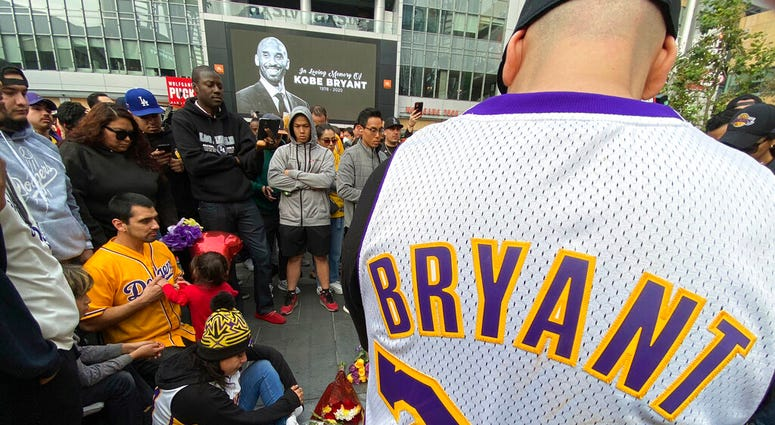 Fans mourn the loss of Kobe Bryant with makeshift memorials in front of La Live across from Staples Center, home of the Los Angeles Lakers in Los Angeles on Sunday, Jan, 26, 2020. Bryant, the 18-time NBA All-Star who won five championships and became one