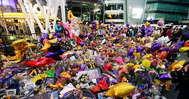 Fans gather at a memorial for the late Kobe Bryant in front of Staples Center in Los Angeles, Sunday, Feb. 2, 2020. Bryant, the 18-time NBA All-Star who won five championships and became one of the greatest basketball players of his generation during a 20