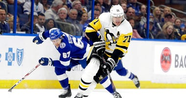 Pittsburgh Penguins center Evgeni Malkin (71) breaks out ahead of Tampa Bay Lightning center Mitchell Stephens (67) during the first period of an NHL hockey game Thursday, Feb. 6, 2020, in Tampa, Fla.