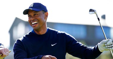 Tiger Woods smiles after hitting his tee shot on the 16th hole during the Genesis Invitational pro-am golf event at Riviera Country Club, Wednesday, Feb. 12, 2020, in the Pacific Palisades area of Los Angeles.