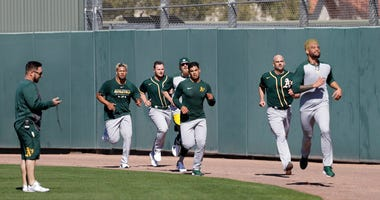 Oakland Athletics' Sean Manaea, front, leads a group of pitchers running during spring training baseball practice, Thursday, Feb. 13, 2020, in Mesa, Ariz.