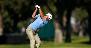 Dustin Johnson hits his second shot on the 11th hole during the second round of the Genesis Invitational golf tournament at Riviera Country Club, Friday, Feb. 14, 2020, in the Pacific Palisades area of Los Angeles