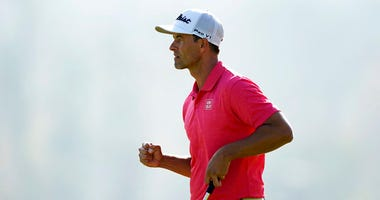 Adam Scott, of Australia, reacts after making a birdie putt on the 17th hole during the final round of the Genesis Invitational golf tournament at Riviera Country Club, Sunday, Feb. 16, 2020, in the Pacific Palisades area of Los Angeles.