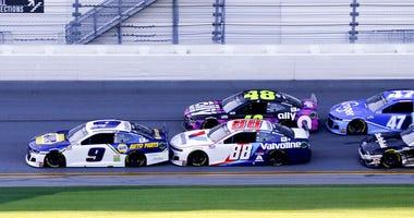 Chase Elliott (9), Alex Bowman (88), Jimmie Johnson (48), Ricky Stenhouse Jr. (47) and Aric Almirola (10) race down the front stretch during the NASCAR Daytona 500 auto race at Daytona International Speedway, Monday, Feb. 17, 2020, in Daytona Beach, Fla.