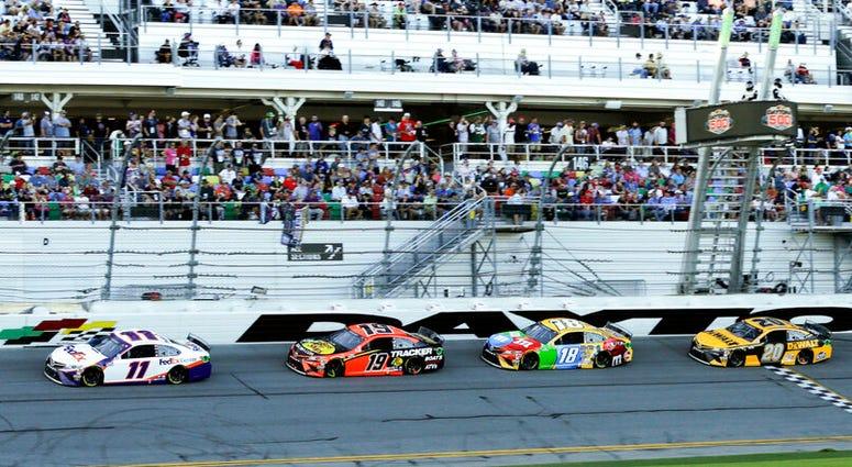 A group of Toyota's run in a single file from left, Denny Hamlin (11), Martin Truex Jr. (19), Kyle Busch (18),Erik Jones (20) and Christopher Bell (95) NASCAR Daytona 500 auto race at Daytona International Speedway, Monday, Feb. 17, 2020, in Daytona Beach