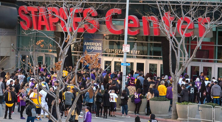 Fans line up to get into the Staples Center to attend a public memorial for former Los Angeles Lakers star Kobe Bryant and his daughter, Gianna, in Los Angeles, Monday, Feb. 24, 2020.
