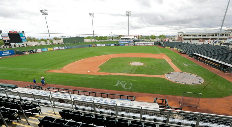 Kansas City Royals' dugout in an otherwise empty ballpark after the cancellation of a spring training baseball game between the Royals and the Seattle Mariners Thursday, March 12, 2020, in Surprise, Ariz.