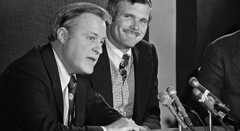 Atlanta Braves chairman Bill Bartholomay, left, and Ted Turner